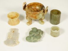 A group of Chinese jades, various colours, comprising; an archaistic axe pendant, 9cm.