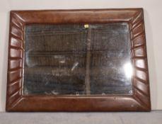 A 20th century leather framed rectangular wall mirror, 118cm wide x 86cm high.