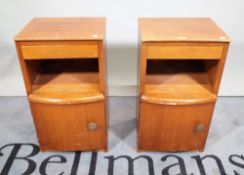 A pair of 20th century stained beech bedside cupboards, 36cm wide x 61cm high, (2).