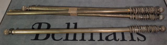 A group of three brass curtain rails, the smaller two each 170cm and the largest 270cm, (3).