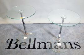 A pair of 20th century chrome and glass occasional tables, on circular glass plinth bases,