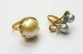 A gold, cultured pearl and diamond set single stone ring, in an abstract twist design,