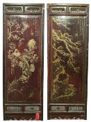 A pair of Chinese framed rectangular panels, gilt decorated with birds and hares amongst foliage,