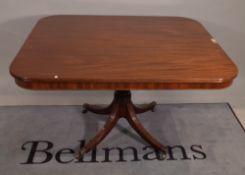 A Regency mahogany breakfast table, the rounded rectangular snap top on four downswept supports,