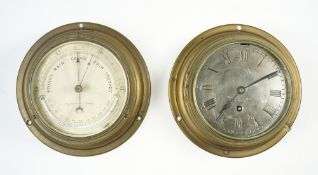 A Negretti and Zambra ships brass cased port hole wall clock,