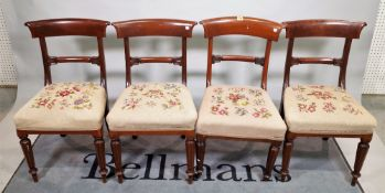 A set of four 19th century mahogany framed bar back dining chairs, on octagonal turned supports,