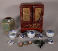 Asian collectables, including; a red leather miniature jewellery box, 20cm wide x 27cm high,