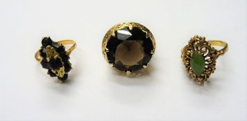 A gold ring, claw set with a circular cut smoky quartz,