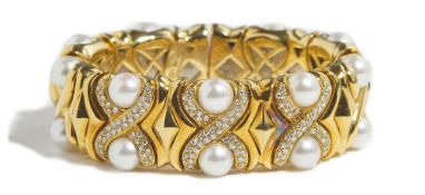 An Italian gold, diamond set and cultured pearl sprung bangle,