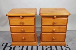 A pair of 20th century pine bedside chests,