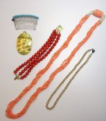 A three row bracelet of coral beads, on a gold rectangular clasp, detailed 750,