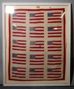 A textile panel 'American flag', framed and glazed, 94 cm x 76 cm overall.