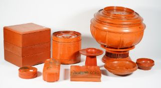 A collection of Chinese red lacquer wares including;