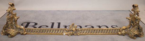 A 19th century brass fire fender with profusely cast acanthus decoration, 178cm long x 37cm high.