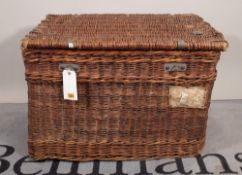 An early 20th century wicker and canvas lined lift top trunk, 79cm wide x 53cm high.