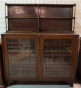 A late Victorian mahogany and brass mounted chiffonier with glazed panelled doors on bracket feet,
