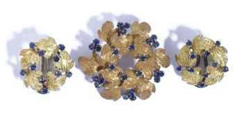 An 18ct gold and sapphire brooch, designed as a hexagonal wreath, having a textured finish,