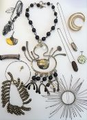 A group of mostly modern studio jewellery, comprising; a circular hair ornament,