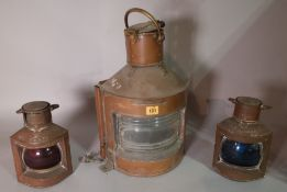 An early 20th century brass ships lantern, 30cm wide x 45cm high and a similar smaller pair,