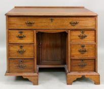 A George III style mahogany kneehole des