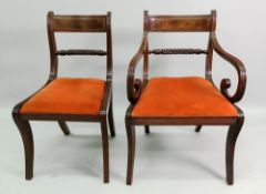 A pair of Regency mahogany dining chairs