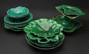 A collection of ten Wedgwood green glazed cabbage leaf moulded plates, dishes and a comport,