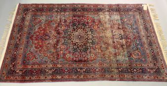 A Kerman rug, with a central medallion s