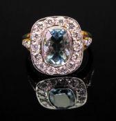 An aquamarine and diamond-set dress ring