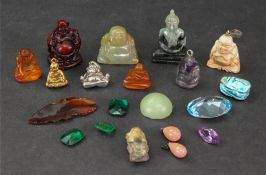A collection of Buddah charms, stones an