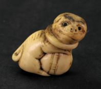 A bone netsuke, carved in the form of a