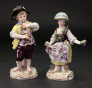 A pair of Meissen figures of vintners, 2