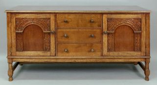 A reproduction carved oak sideboard, in late 17th century style,