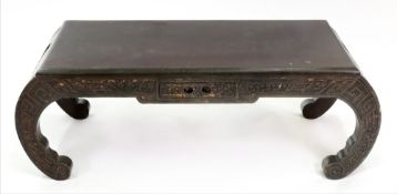 A Chinese carved hardwood low table, 20th century, with frieze drawer and bowed ends,