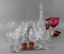 A harlequin set of seven cut pattern drinking glasses, in Regency style, 10cm high,