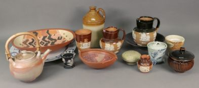 A collection of Studio ceramics including a teapot, a large circular plate and other items,