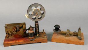 A brass Morse Code machine tapper, labelled A W Gamage Ltd, Holborn, E.C.I, on wooden base, 14.