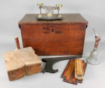 A rectangular oak chest, early 19th century, with hinged top and iron carrying handles,