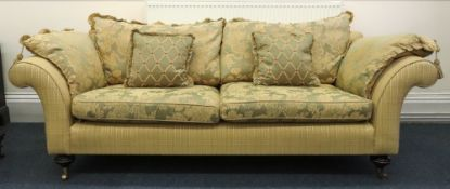 A large reproduction Victorian style upholstered sofa, with scroll arms,
