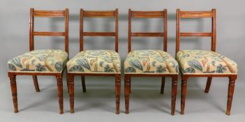 A set of four Edwardian oak dining chairs, with bar backs, on ring turned legs,