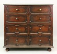 A reproduction Charles II style oak chest, fitted with two short and three long drawers,