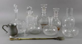 A graduated pair of George III style cut glass decanters, 24 & 21cm high,