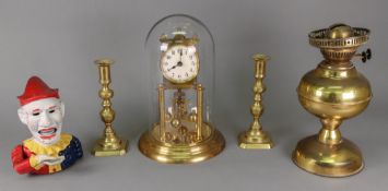 A brass Anniversary timepiece, with cream dial and silk suspension, under a glass dome, 29cm high,