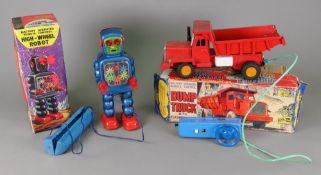 A tin plate battery operated remote control dump truck and a KO battery operated remote control