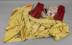 A yellow cotton coverlet, the field embroidered with coloured threads,