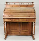 A reproduction late 19th century style hardwood cylinder font desk,