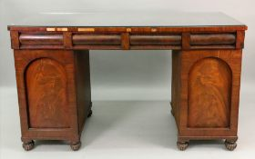 An early Victorian mahogany sideboard, the rectangular top above three frieze drawers,