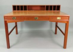 A retro teak Military style desk, circa 1970's, with a low raised back fitted with pigeon holes,