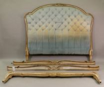 A Louis XV style cream and gilt painted frame double bed, foliate and shell carved,
