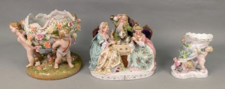 A continental porcelain figure group taking tea, circa 1900, 21cm wide,