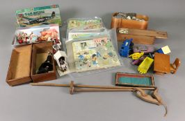 A collection of five vintage wooden puzzles, wooden cased bone and ebony dominions,